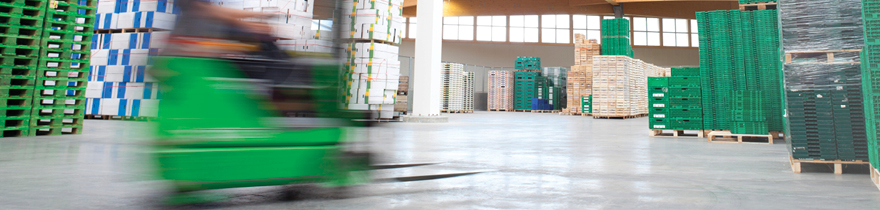 Forklift being operated within warehouse